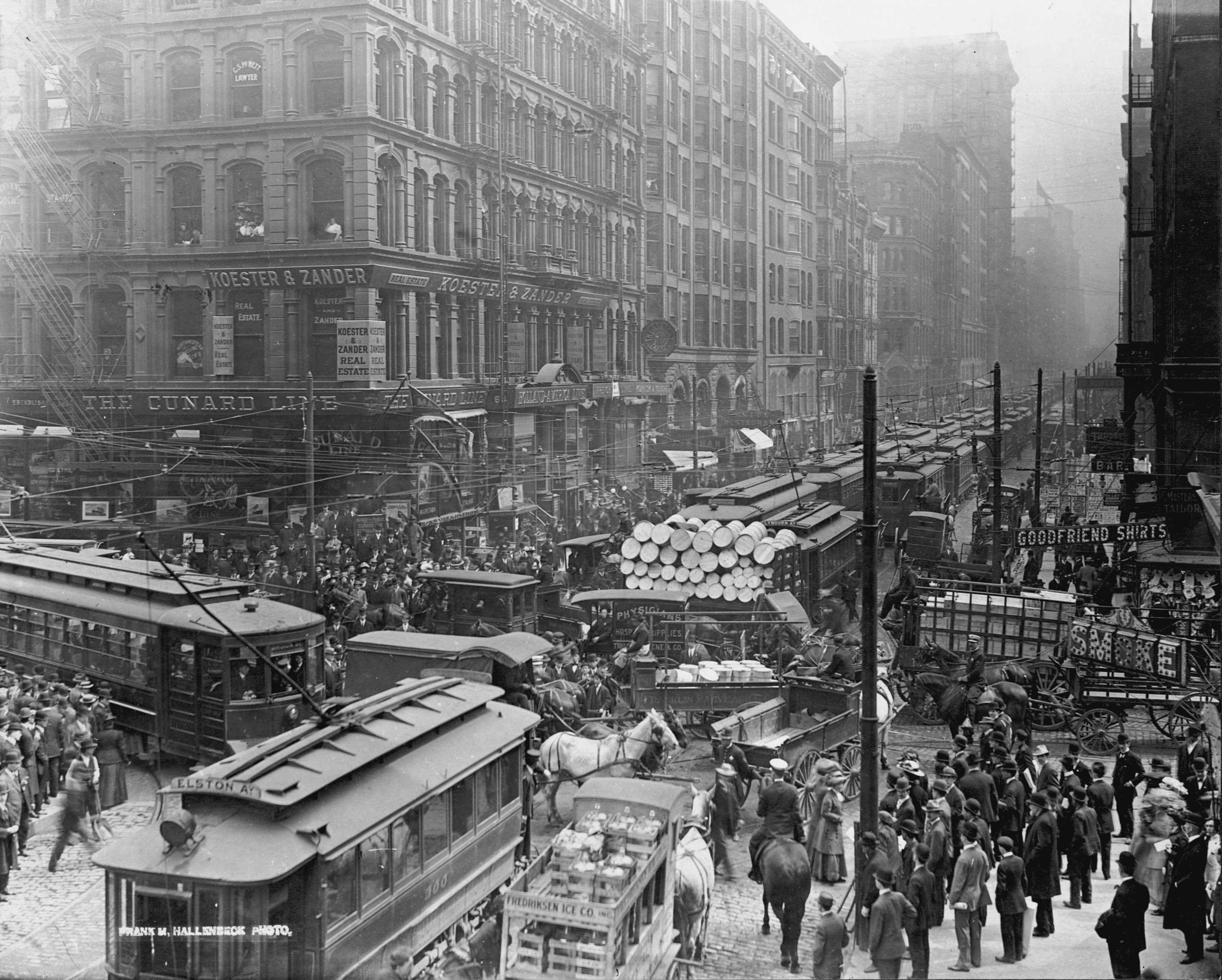 Traffic jam on Dearborn Street near Randolph Street; Chicago, Illinois; 1909. Several trolleys and horse-pulled carts on the street.